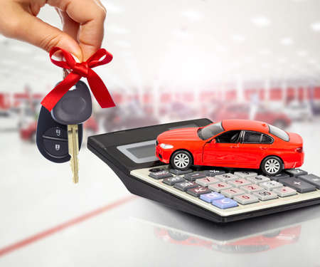 Car and calculator. Auto dealership and rental concept background. Stockfoto
