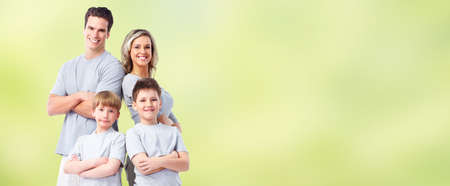 Happy family with kids over green abstract background. Stockfoto