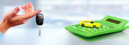 Car and calculator. Auto dealership and rental concept background. Standard-Bild