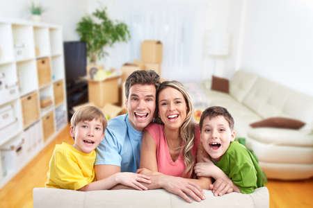 Happy family with children in new house. Real estate concept. Stock Photo