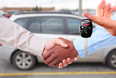 Car dealer with client handshake. Auto dealership and rental concept. Stock fotó