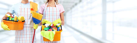 Young professional Housemaid woman. Cleaning service background. Stock Photo - 63349397