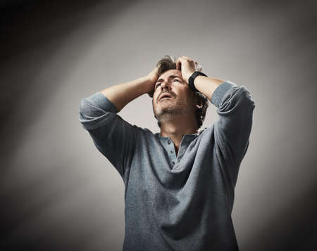 Emotional face expression of despair hopeless man. Imagens