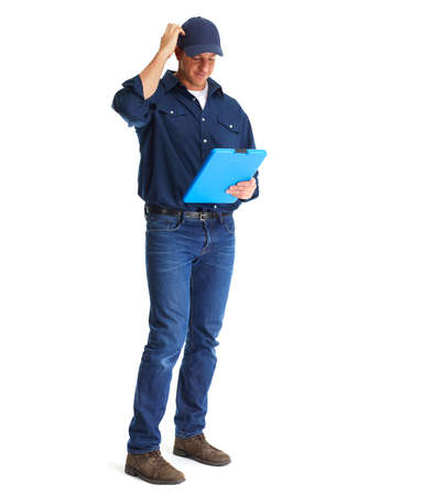 Handsome plumber with clipboard isolated white background. Фото со стока