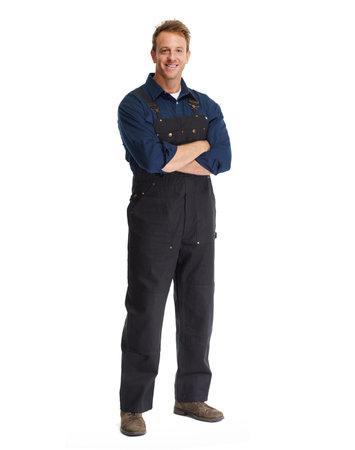Aantrekkelijke jonge werktuigkundige van de auto in uniform geïsoleerde witte achtergrond.