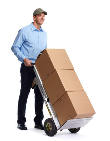 Smiling postman with a box isolated over white background.