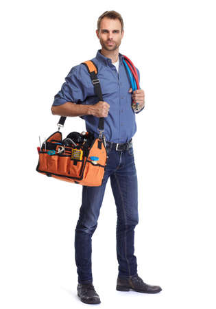 Handsome plumber with tool bag isolated white background. Stock Photo