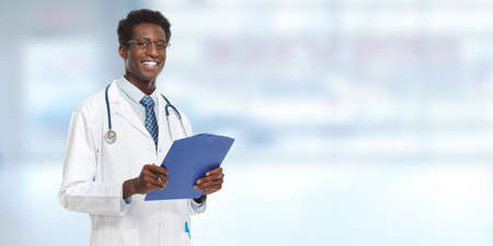 Young Afro-American doctor man. Health care concept.