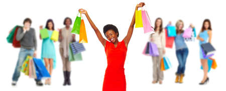 Group of happy customers with shopping bags isolated white background. Stock Photo