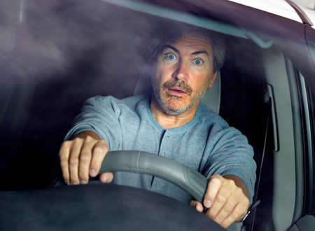 Scared car driver man accident stress frustration on traffic. Stock Photo