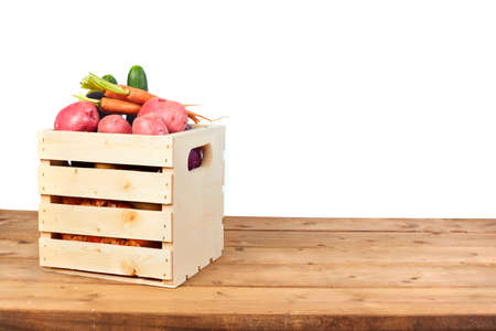 Organic Vegetables in case on wooden table. Grocery harvest concept.