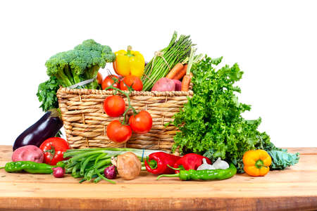 Organic vegetables on wooden table isolated white background