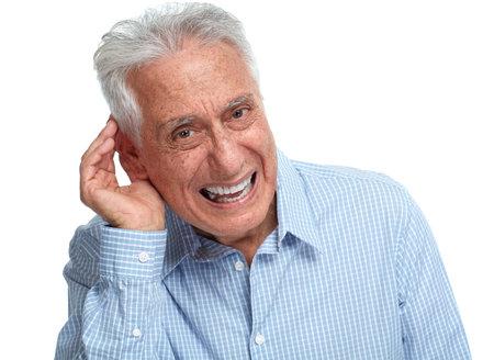 Deaf old man holding hand near ear listening.