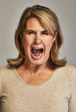 Angry roaring senior woman People rage expression.