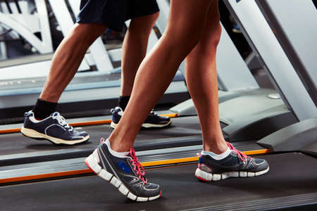 Group of people Legs running on treadmill Stock Photo - 65516520