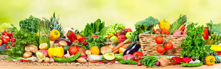 キッチンのテーブルで有機野菜や果物各種 写真素材