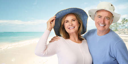 Happy elderly couple enjoying together on the beach.