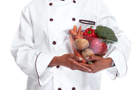 African chef baker woman hands with vegetables isolated white background.