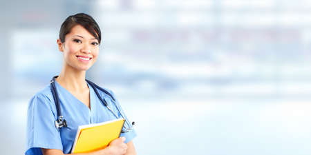 Asian medical doctor woman over blue clinic background.