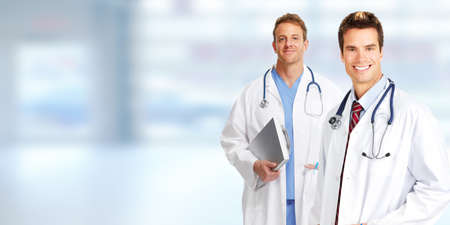Group of medical doctors over blue clinic background. Stock Photo
