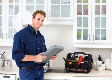 Professional plumber doing renovation in kitchen home. Reklamní fotografie