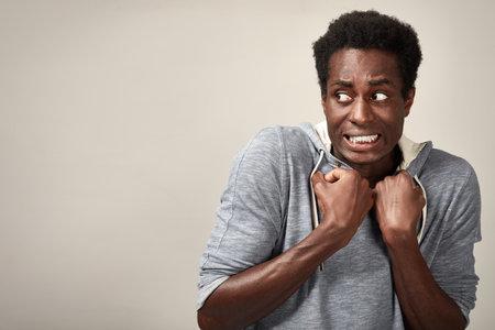 Scared nervous african american man. People emotions portrait. 版權商用圖片