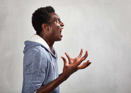 Angry fury african american man portrait. People face expressions. Stock Photo