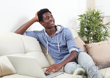 American man talking with family online laptop. Фото со стока