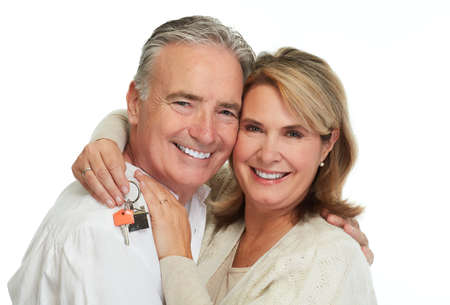 Mature couple with house key. Real estate mortgage.