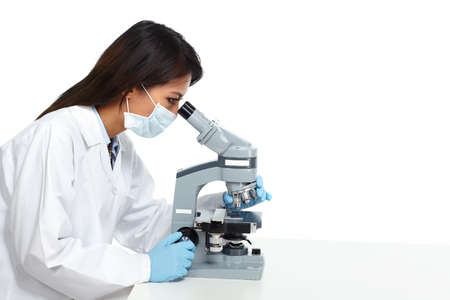Chinese scientist woman working with microscope in laboratory. Stok Fotoğraf