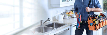 Professional plumber working renovation in kitchen home.