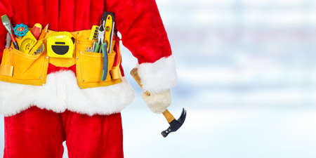 Santa construction worker with tool belt. Christmas renovation concept 스톡 콘텐츠