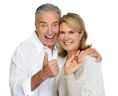 Senior couple with house key.