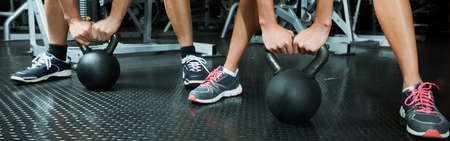 Hands with dumbbell Stock Photo