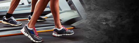 Legs on treadmill Stock Photo