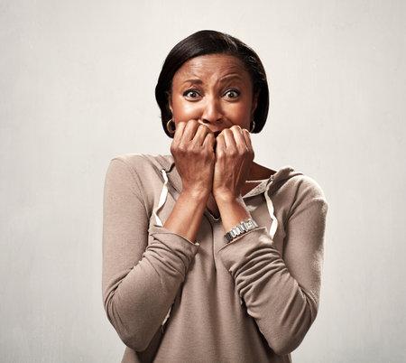 Scared black woman. 스톡 콘텐츠