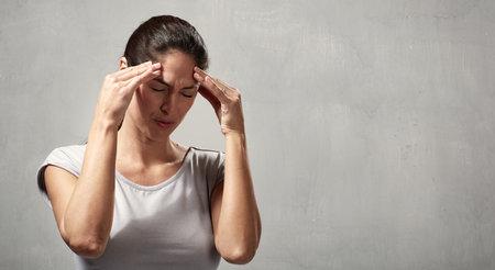 Woman headache Stock Photo