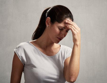Woman headache Standard-Bild
