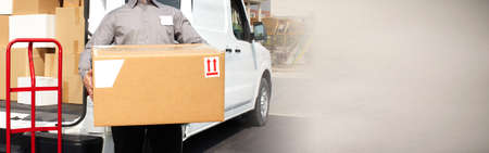 Delivery postman hands with a box Banco de Imagens - 73296538