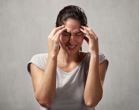 Woman headache Banque d'images