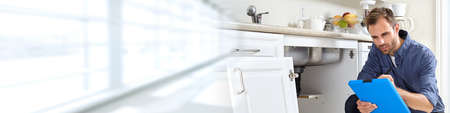 Plumber with clipboard. Standard-Bild