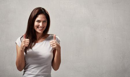 Glückliches Mädchen Daumen Standard-Bild