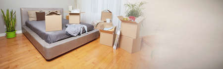 Moving boxes in new apartment 스톡 콘텐츠