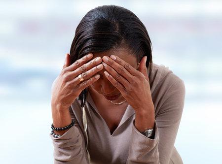 Woman having a migraine headache.