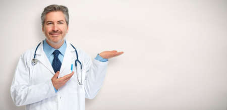 Doctor pharmacist presenting gray background