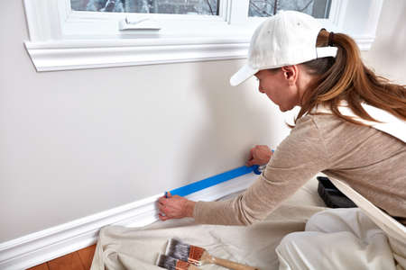 Woman painting wall Stock Photo - 76701334