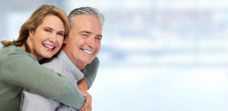 Senior couple smiling.