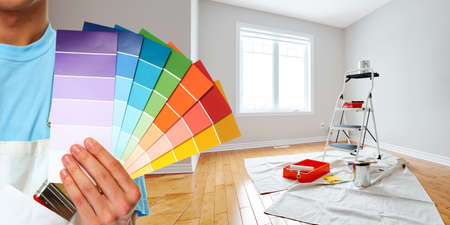 Painter hand with colors Stock Photo