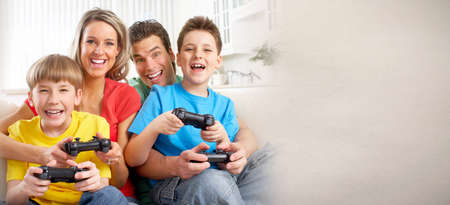Family playing video game Banque d'images