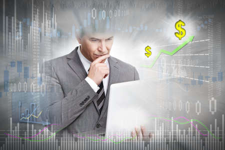 Investor with laptop computer Stock Photo